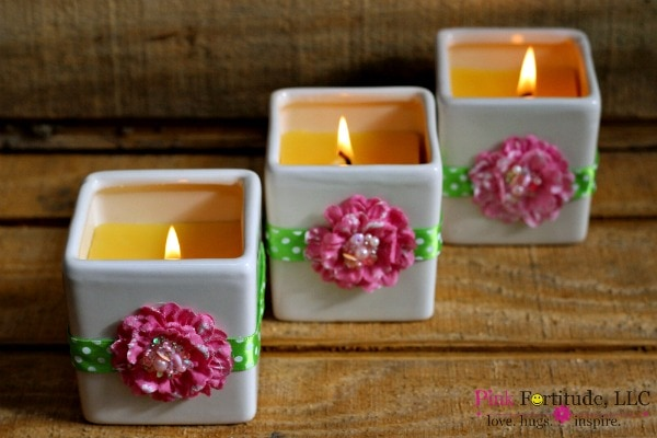 DIY beeswax candles in succulent planter with pink flower details