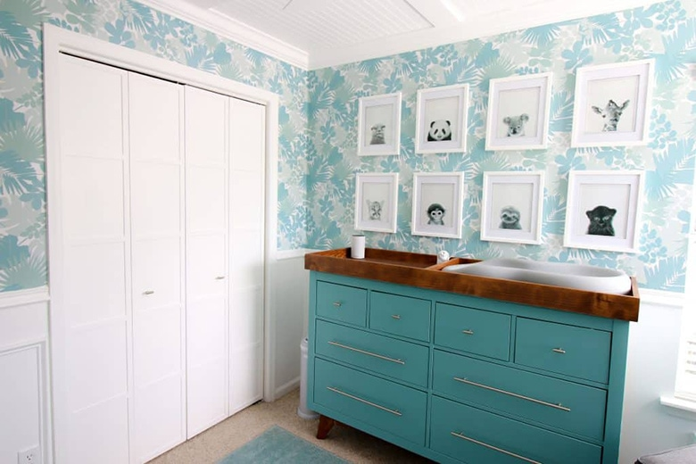 teal mid-century dresser made into a changing table