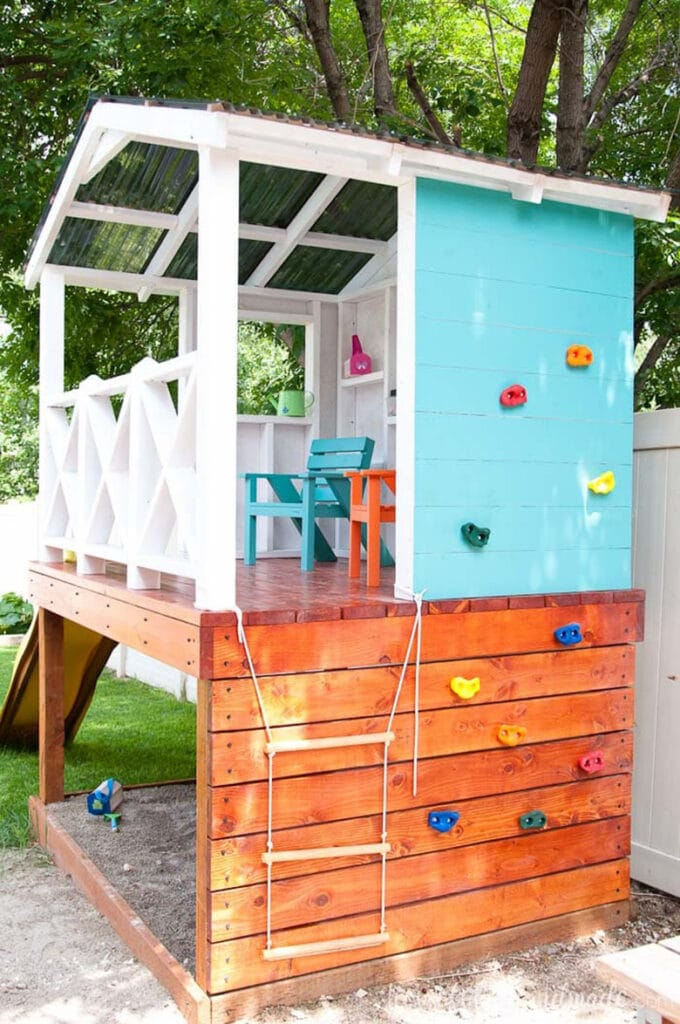 Outdoor playhouse with climbing wall and loft