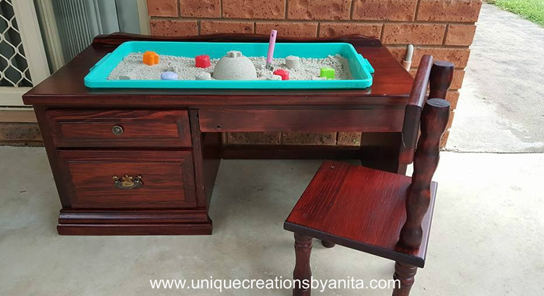 repurposed desk into a sand pit play box