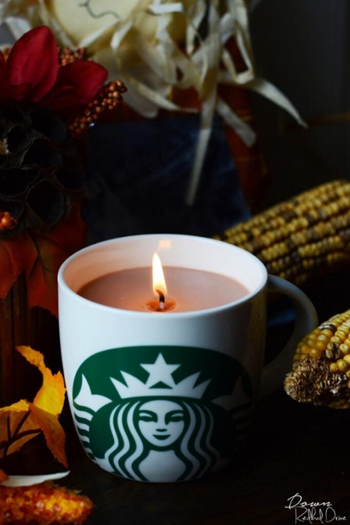 pumpkin spice latte candle in a starbucks mug