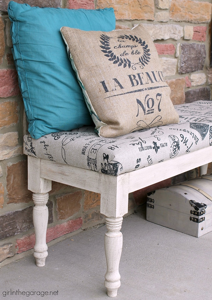 Ballard designs inspired bench with white distressed legs and french country printed tufted cushion