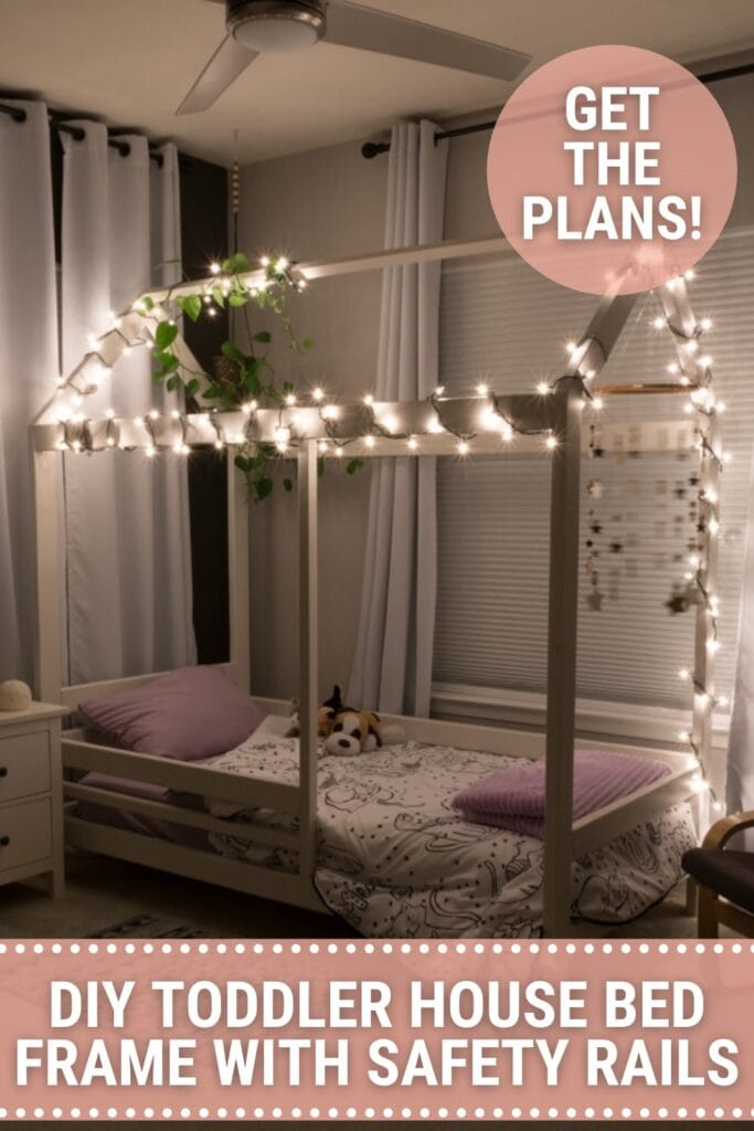 Toddler house bed with string lights lit up and text DIY Toddler House Bed Frame with Safety Rails, Get the Plans