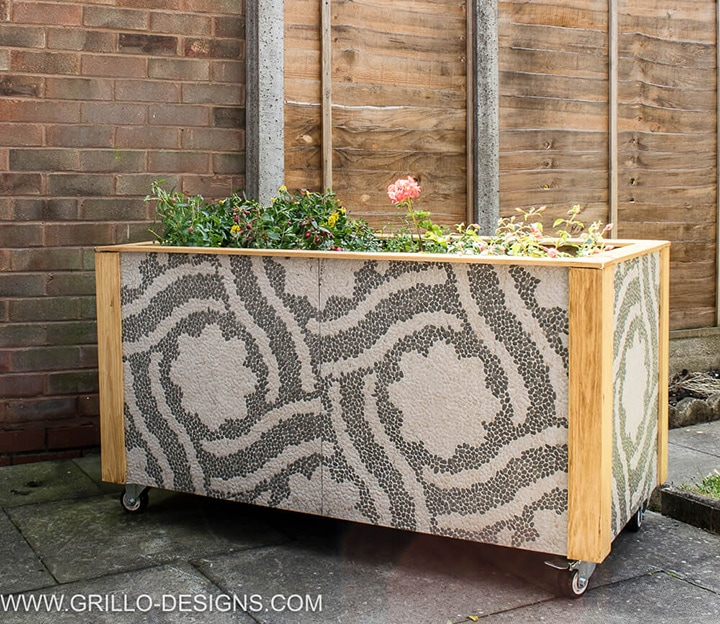 beautiful outdoor planter box using tiles