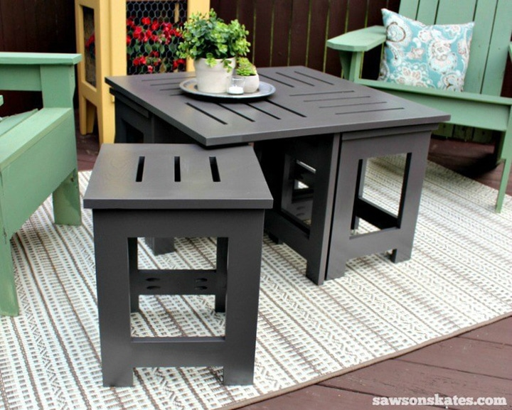 DIY outdoor coffee table with four hidden side tables