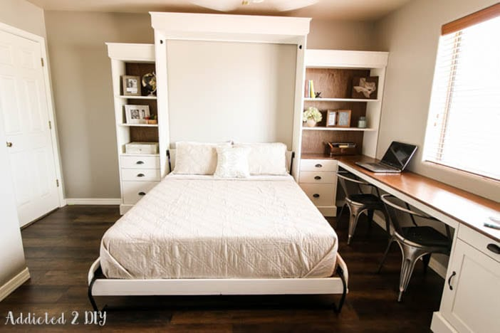 White Murphy bed pulled down in a home office