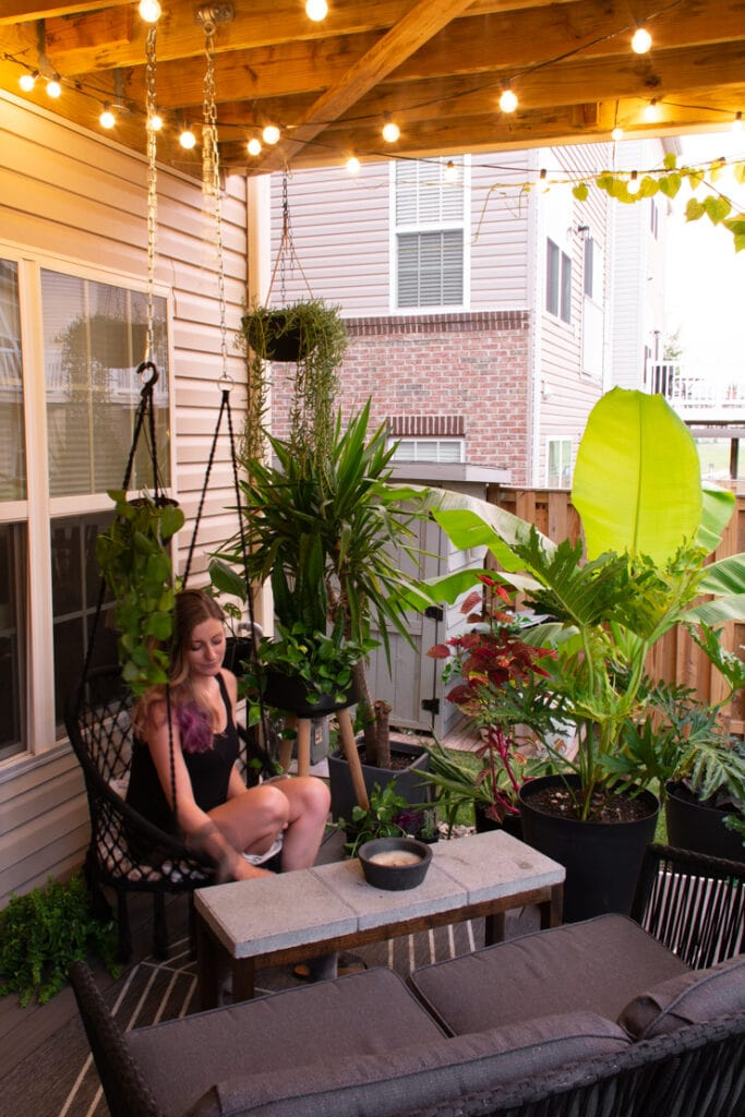 townhouse deck ideas with string lights, a rope swing, and lots of plants
