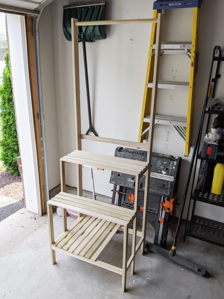 DIY tiered plant stand with room for hanging plants and grow lights