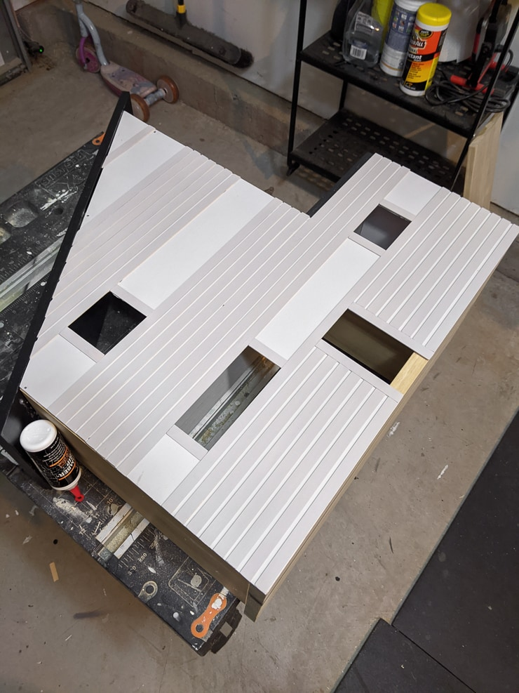 gluing on the balsa wood dollhouse siding