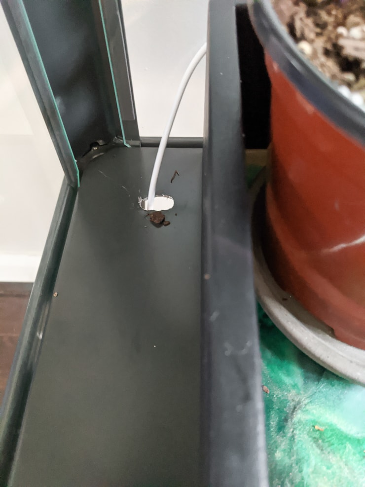 hole in the greenhouse cabinet for lighting cord
