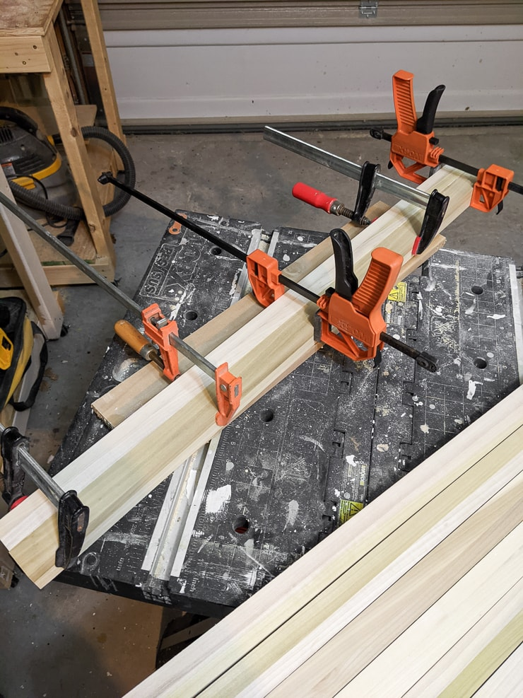 edge gluing boards to create the top of the desk