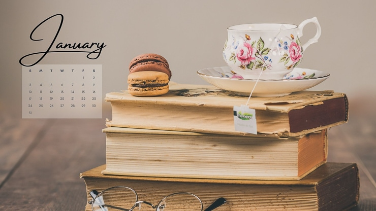 books, teacup, and macaroons with calendar