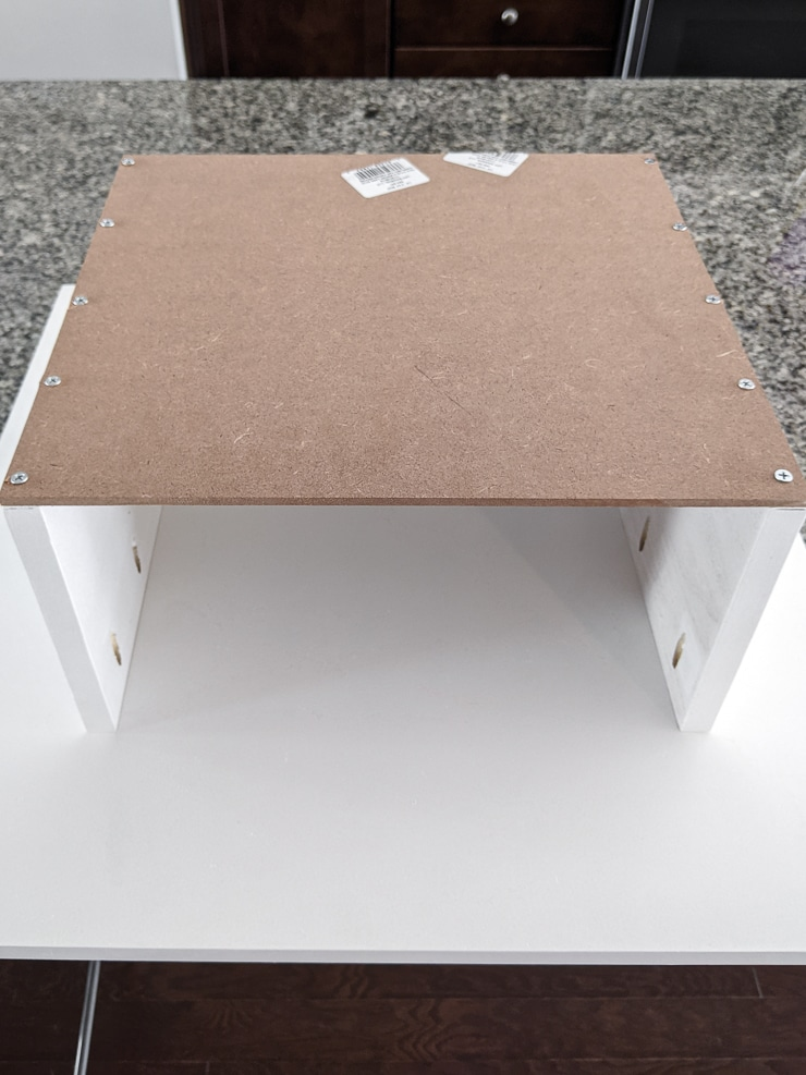 showing how the storage area attaches to the bottom of the table