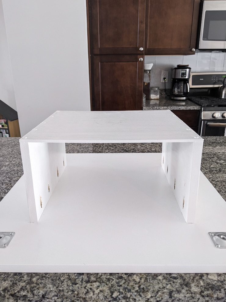 base plates attached to the bottom of the table for the legs