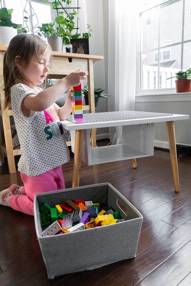 toddler playing with the finished easy DIY lego table
