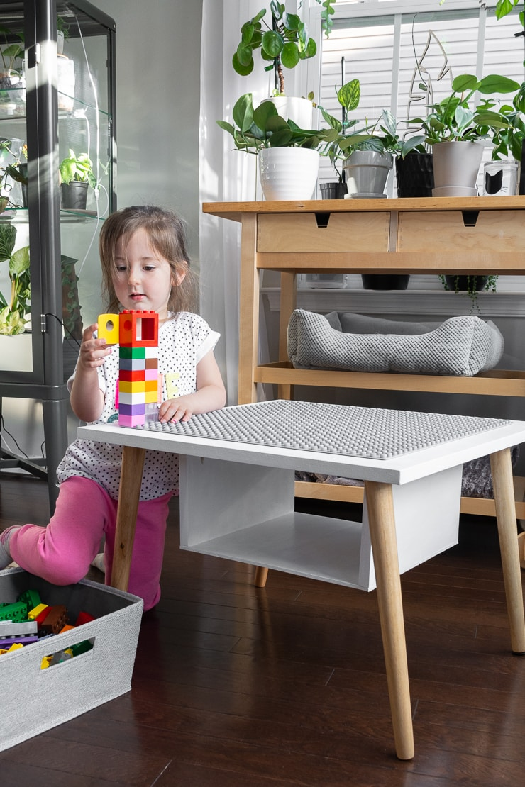 toddler playing with the finished DIY lego table