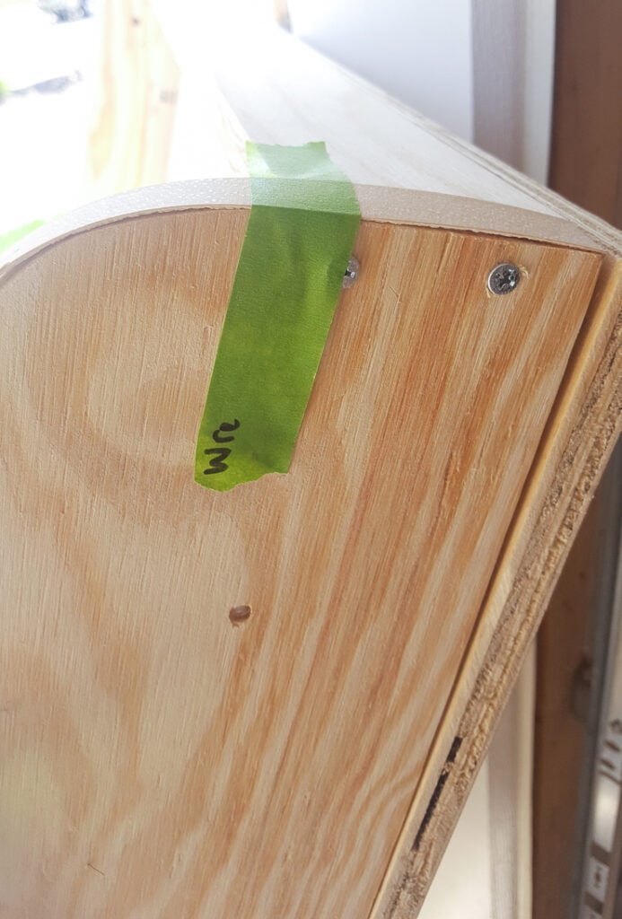 iron-on veneer edge banding applied to wood to finish plywood edges for painting