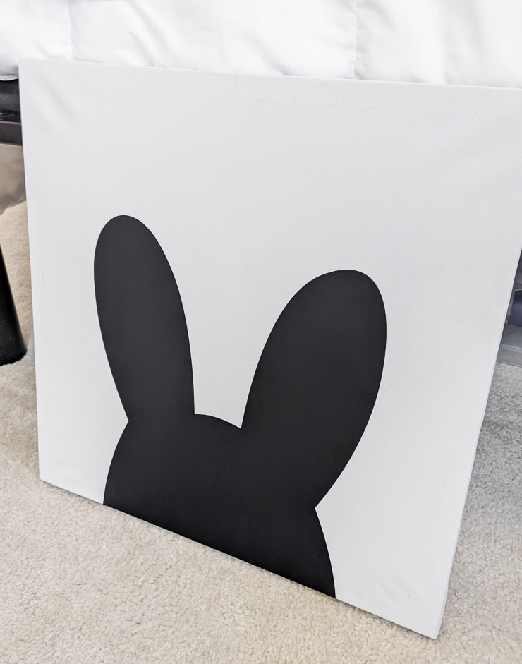 shape of a bunny in vinyl on a canvas to make thrifted kids room decor