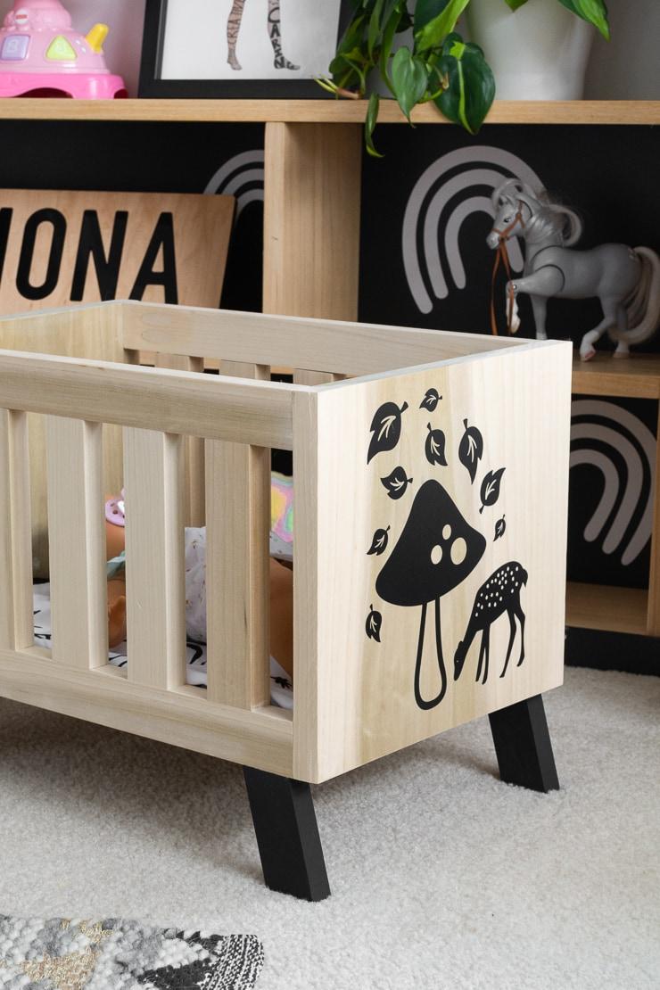 vinyl decals on the side of a DIY modern babydoll crib