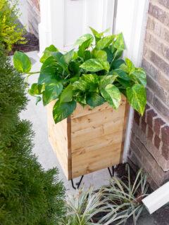 DIY porch planter with hose storage