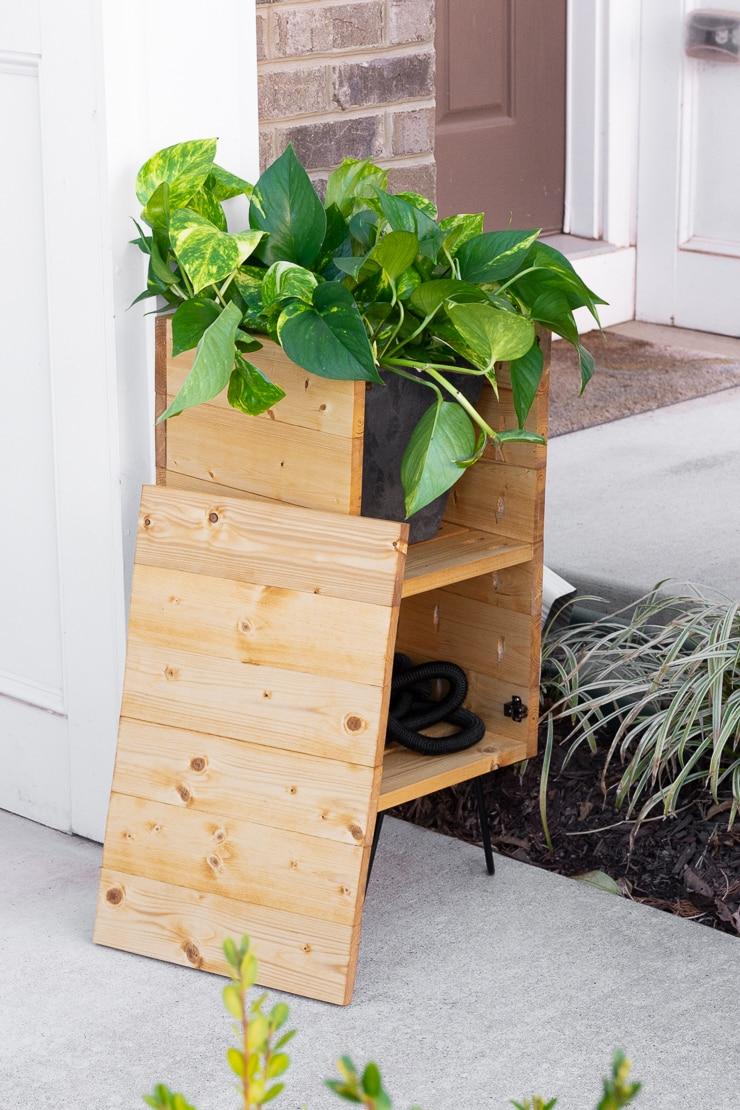 DIY planter with hose storage