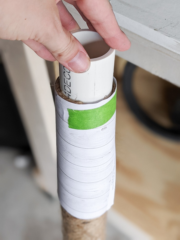 paper tapes over the jute to spray paint the top of the PVC pipe