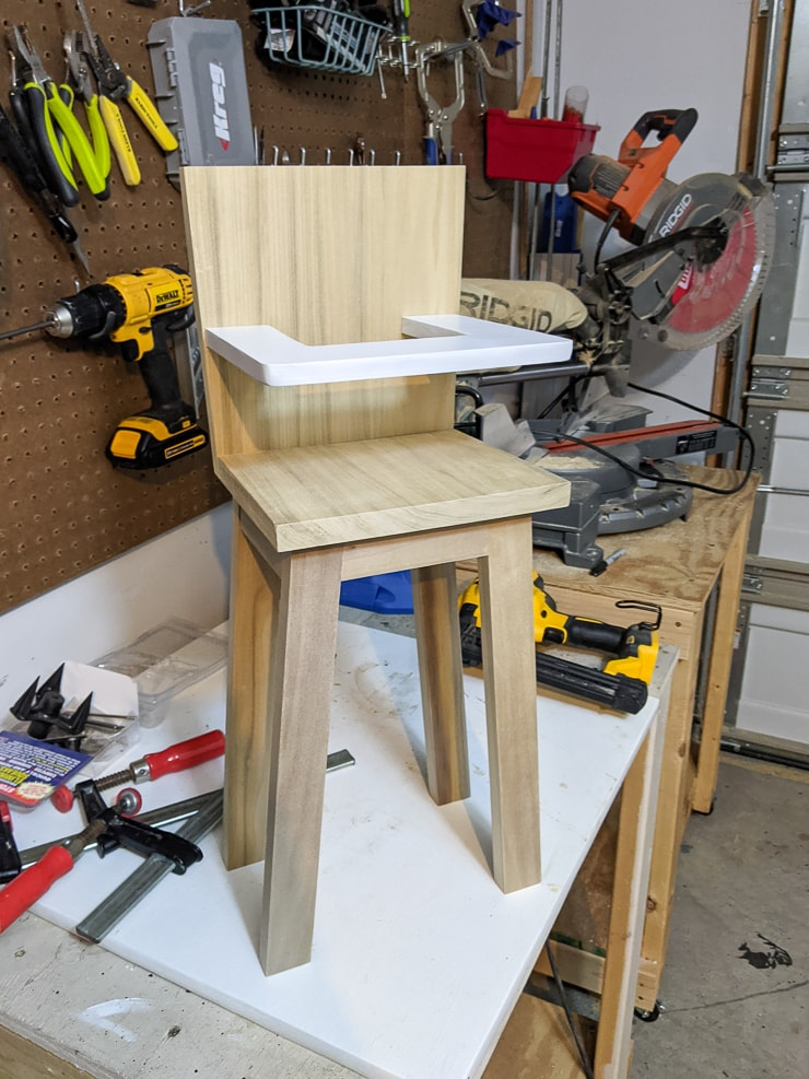 attaching the tray to the wood doll high chair