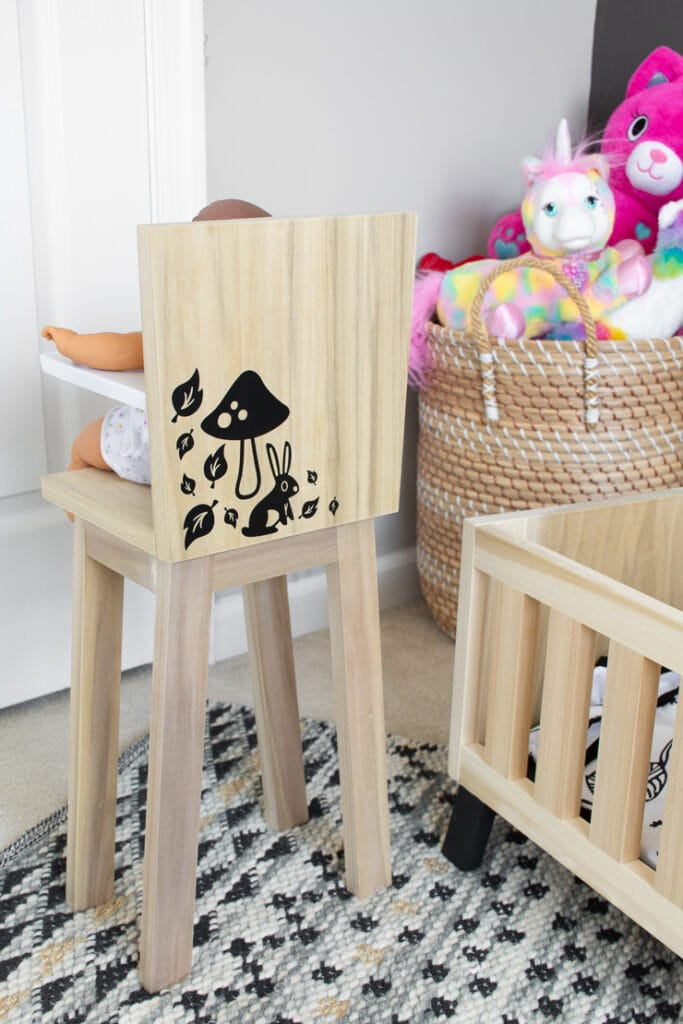 finished modern wooden doll high chair in a cute kids room