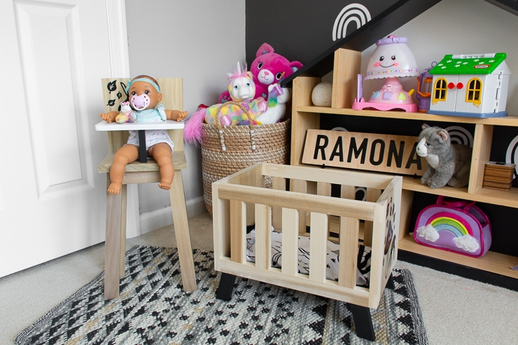 gorgeous modern kids room with a cute doll high chair and crib
