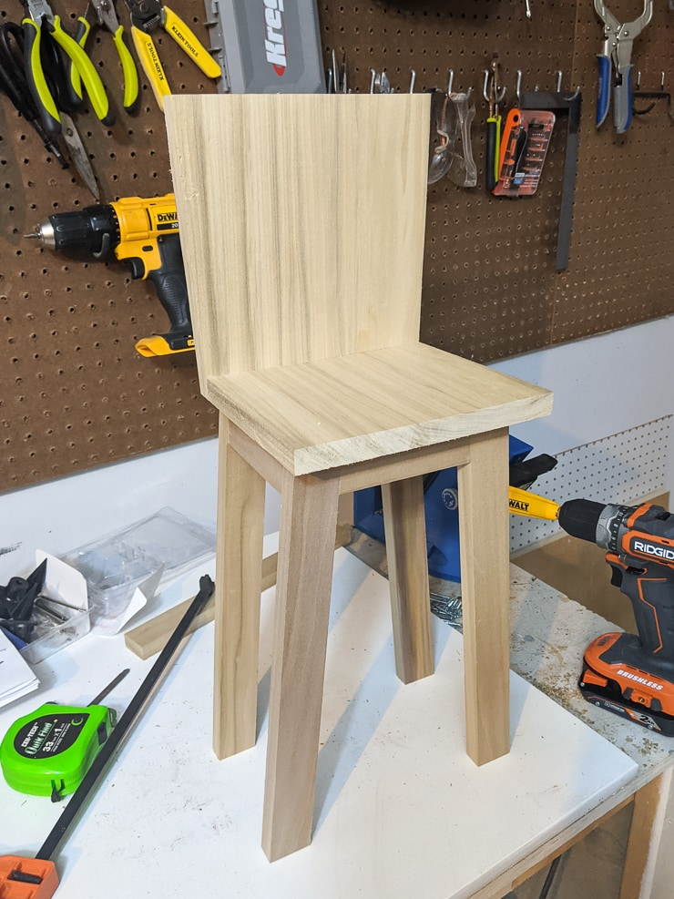 attaching the high chair seat to the base