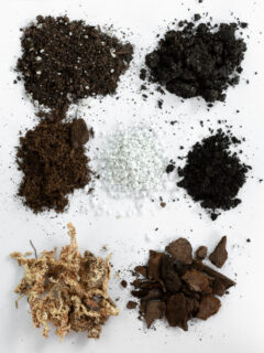 soil additives for houseplant soil in piles on a table