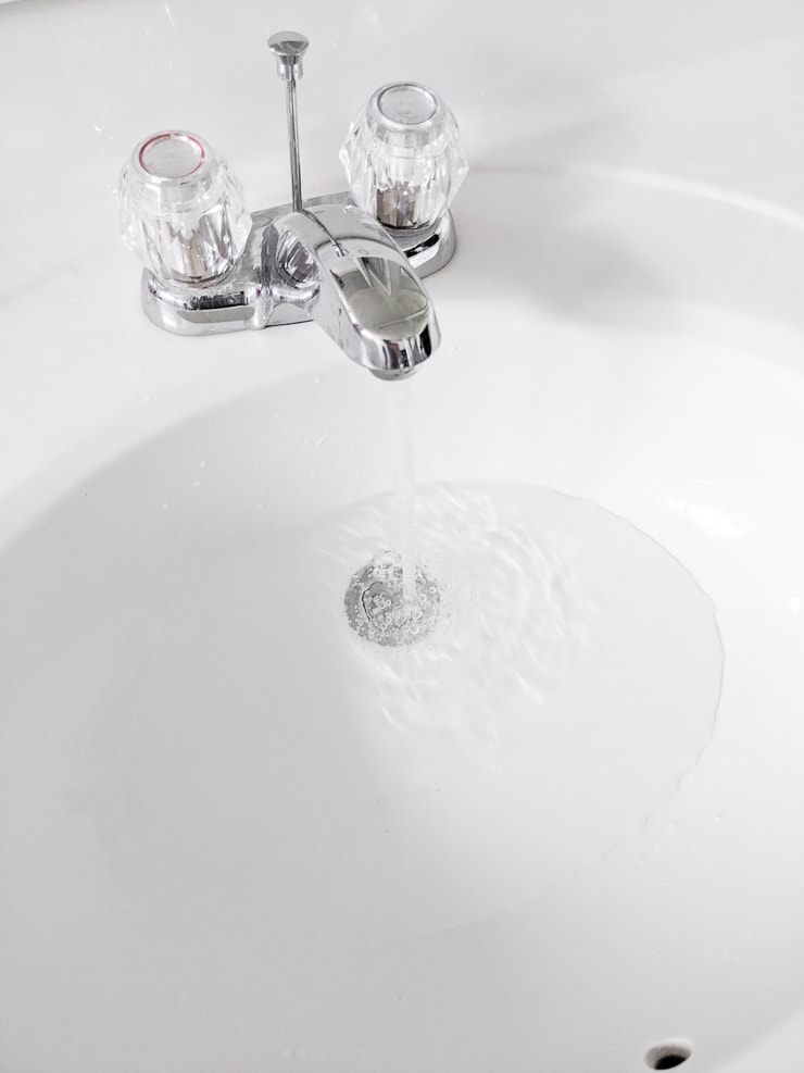 filling a bathroom sink with water