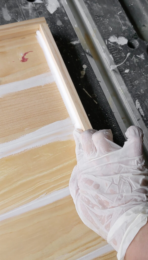 caulking a wooden table top with a raised edge for resin