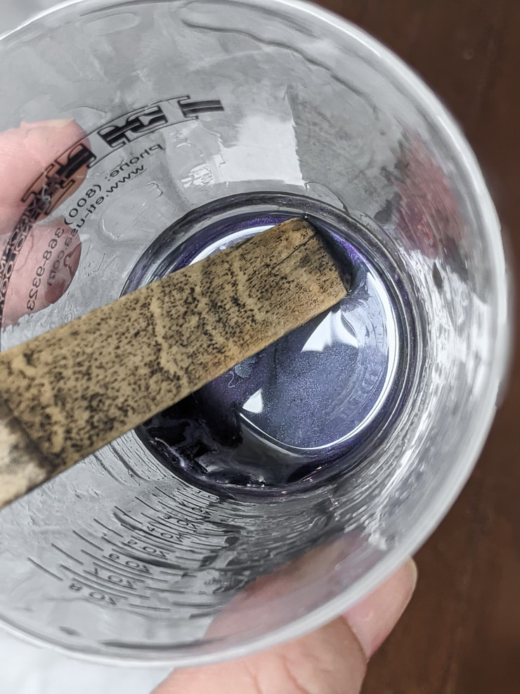 mixing resin in a cup