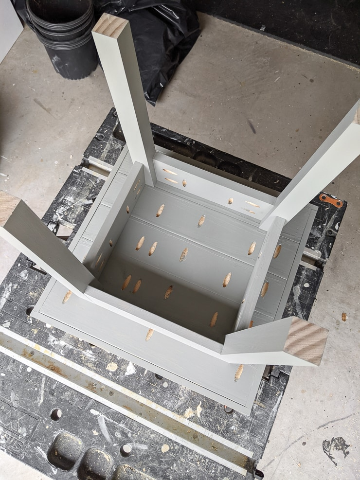 small outdoor side table upside down on a workbench