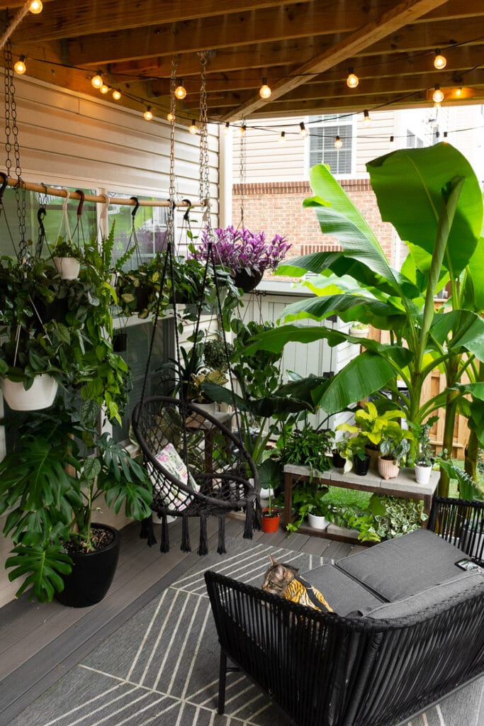 beautiful small townhouse patio decorating ideas with hanging plants and patio furniture
