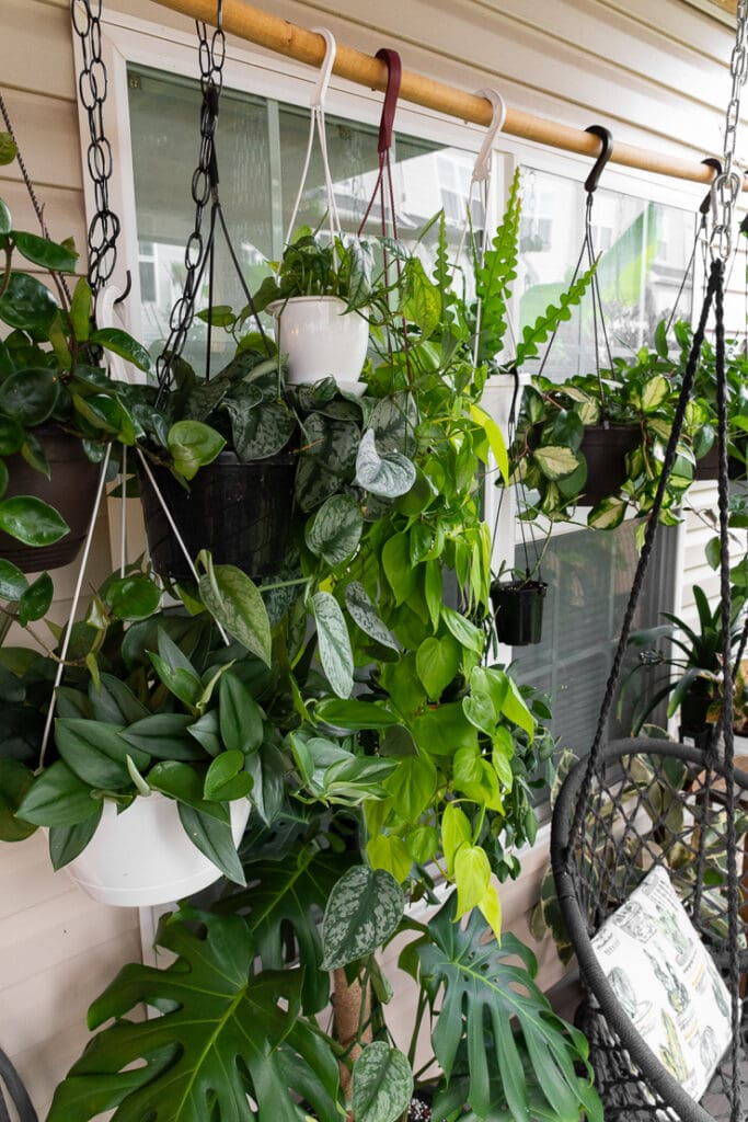beautiful small townhouse patio decorating ideas with hanging plants with a swing