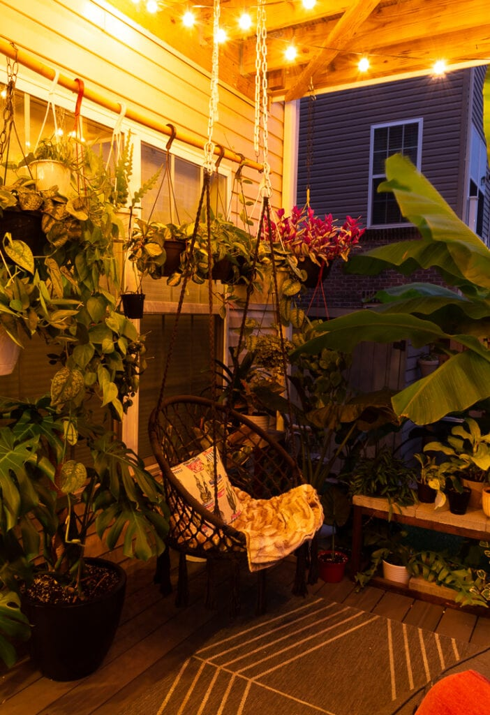beautiful small townhouse patio idea with plants and lights