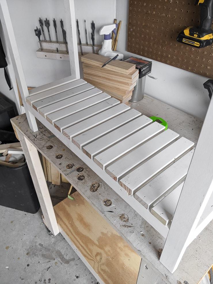 attaching slats to the bottom shelf