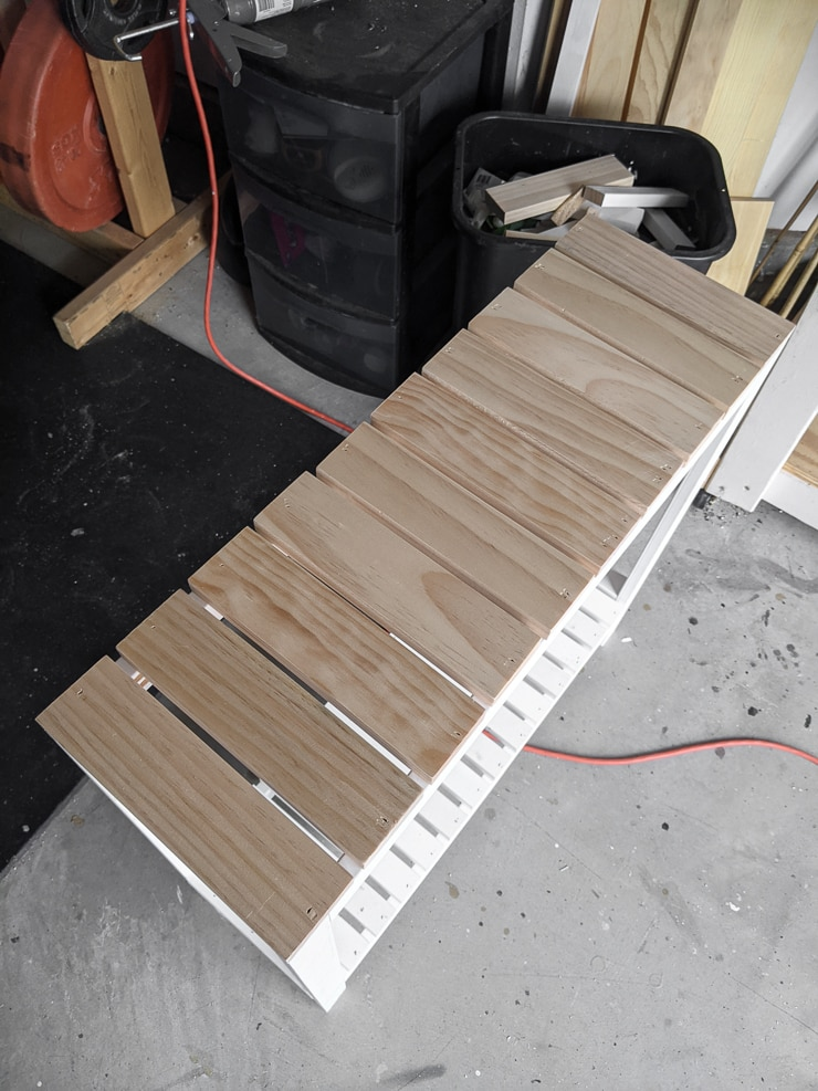 attaching slats to the top shelf