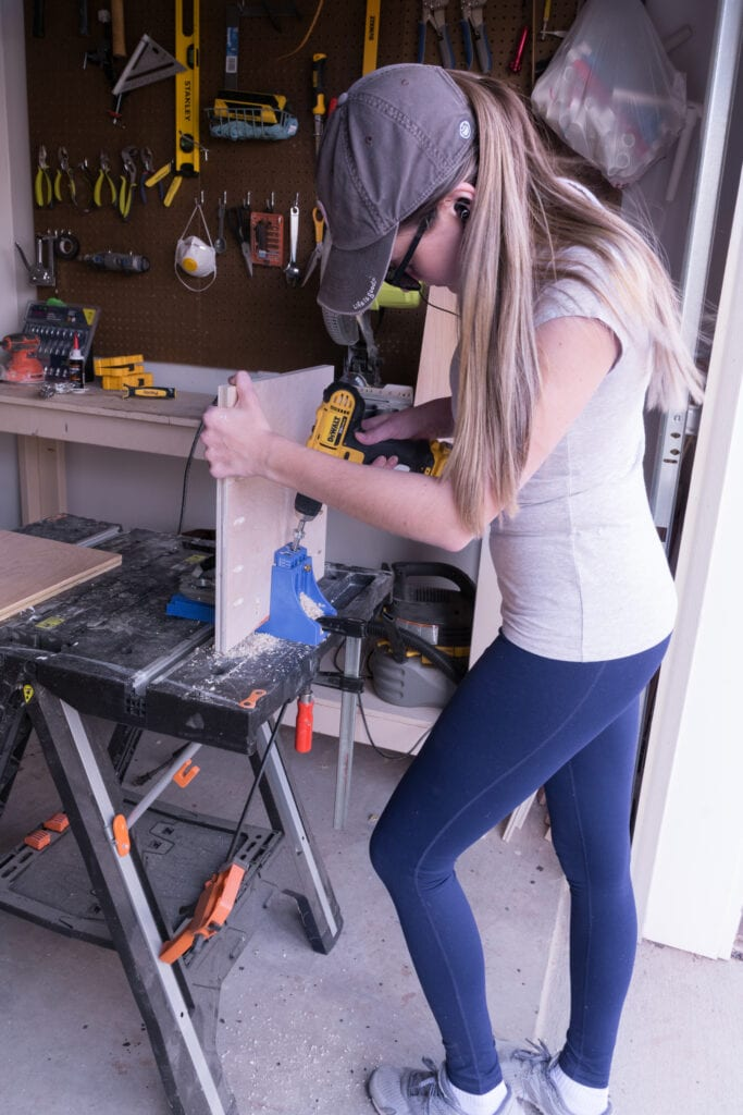 Woman with a drill in a garage